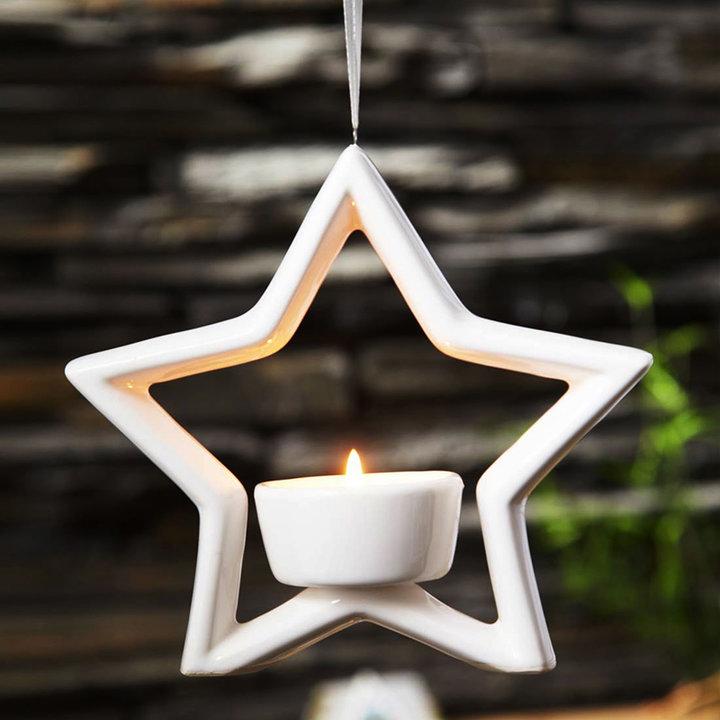 爱屋格林·五角星镂空陶瓷个性烛台图片